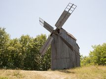 Old wooden mill. The internal mechanism of how the windmill works. stock images