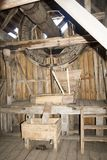 Old wooden mill. The internal mechanism of how the windmill works stock photo