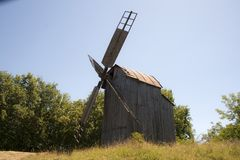 Old wooden mill. The internal mechanism of how the windmill works. royalty free stock photo