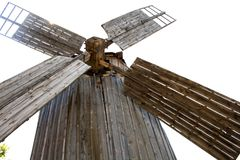 Old wooden mill. lonel. Old wooden mill. The internal mechanism of how the windmill works.lonely old wooden mill. Summer day. Forest stock photography