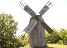 Old wooden mill. lonel. Old wooden mill. The internal mechanism of how the windmill works.lonely old wooden mill. Summer day. Forest royalty free stock image