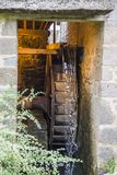 The old wooden mill wheel. In Normandy, France royalty free stock photography
