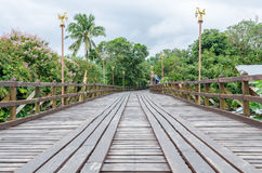 Old wooden Mon Bridge in Sangkhla Buri Stock Photo