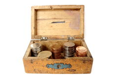 Old wooden moneybox. Very old wooden moneybox filled with romanian currency Stock Photo