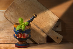 Old Wooden Mortar with Basil Stock Photography