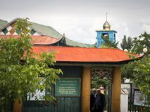 Old wooden mosque, entrance with yellow pillars and red roofs royalty free stock photos