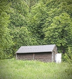 Old wooden mountain hut in a forest Stock Images