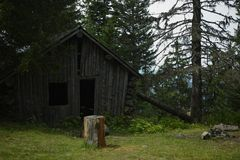 Old wooden mountain hut refuge for hikers, protect against bad w stock photo