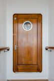 Old wooden narrow door on vintage ship Royalty Free Stock Photography