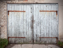 Old wooden neglected garage door Stock Photo