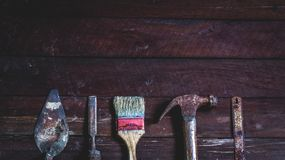 Old wooden with old rusty carpentry tools. Old wooden with rusty carpentry tools; hammer, paint brush, chisel, hacksaw, mortar. horizontal mockup stock photos
