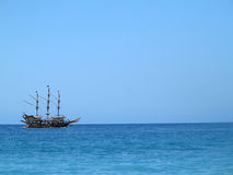 Old wooden old ship in blue sea Royalty Free Stock Photography