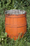 Old wooden orange barrel. Old wooden orange barrel on the green grass Stock Image