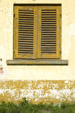 Old wooden orange shutters on window , Bulgaria Stock Images
