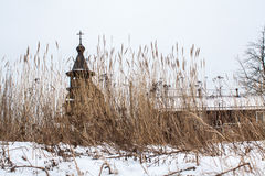 Old wooden orthodox church behind a dry grass Stock Photo