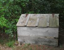 Old wooden outside storage box with lid. Royalty Free Stock Photography