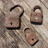 Old wooden padlocks. On wooden background Royalty Free Stock Photo