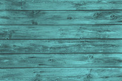 Old wooden painted background in turquoise color. Royalty Free Stock Images