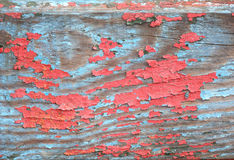 Old wooden painted blue and red rustic background. Paint peeling royalty free stock image