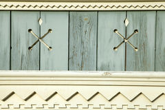 Old wooden painted light blue rustic background with carved elem Stock Photos