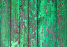 Old wooden painted light green rustic fence, paint peeling background. Stock Photos