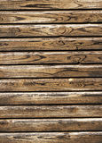 Old wooden painted planks. Old yellow, brown wooden planks Stock Photo