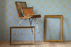 Old wooden painting table top, and old frames. Stock Images
