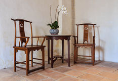 Old wooden pair chair. And one round table Stock Image