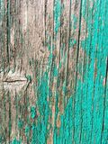 Old wooden panel with green paint peeling off stock images
