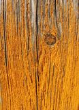 Old wooden panel with yellow paint peeling off stock photos