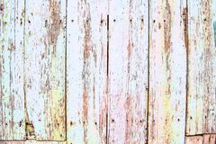 Ancient pastel-colored wooden panels, grungy background royalty free stock photography