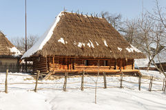 Old Wooden Peasant`s House With Straw Roof Stock Image