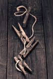 Old wooden pegs on wooden table Stock Photography