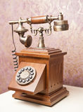Old wooden phone. Vintage wooden telephone on white table. Retro Royalty Free Stock Photos