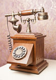 Old wooden phone. Vintage wooden telephone on white table. Retro. Phone royalty free stock photo