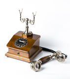 Old wooden phone on white. Background Royalty Free Stock Images