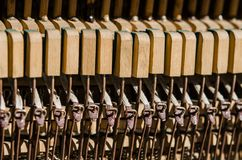Old wooden piano keys under the rays of the Sun. Closeup royalty free stock photo