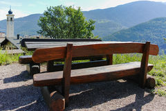 Old wooden picnic table in roadside rest area in Trentino, Italy Stock Images