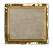 Old wooden picture frame with blank canvas isolated on white bac Royalty Free Stock Image