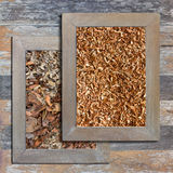 Old wooden picture frame, sawdust, dry leaves. Stock Images