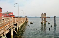 Old wooden pier along the waterfront in Astoria, Oregon. Along the waterfront in Astoria, Oregon Stock Photography