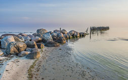 Old wooden pier in the Baltic sea Stock Photography