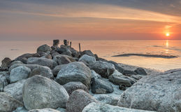 Old wooden pier in the Baltic sea Stock Photo