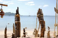 Old wooden pier on the beach Stock Photos