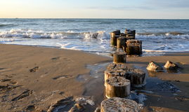 Old wooden pier on beach Stock Images