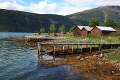Old wooden pier and the boathouses Stock Image