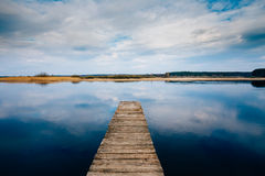 Old Wooden Pier. Calm River Stock Photo