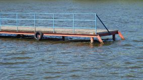 Old wooden pier in a fine sunny day Royalty Free Stock Photos