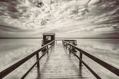 Old wooden pier for fishing, small house shed and beautiful lake Stock Photos