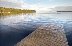Old wooden pier goes under deep water Stock Image